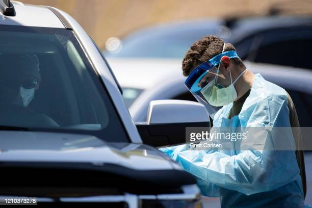 A member of the Tennessee National Guard gathers information at a coronavirus drive thru testing site on April 18 2020 in Springfield Tennessee...