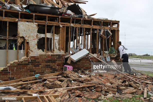 A member of the Texas Task Force 2 search and rescue team works through a destroyed apartment complex trying to find anyone that still may be in the...