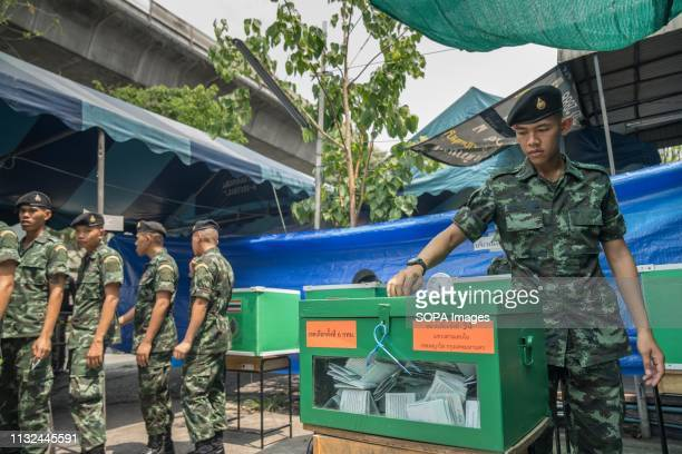 A member of the Thai military seen casting his ballot at a polling station Thailand is hosting its first General Election in 8 years Polling stations...