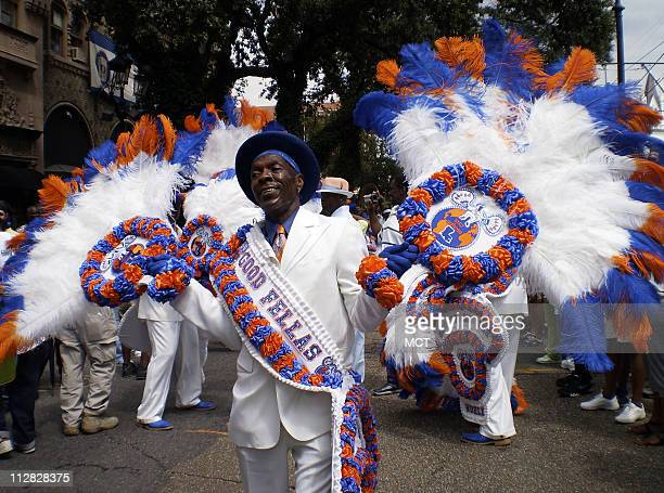 A member of the the Goodfellas Social Aid and Pleasure Club helps to kick off a second line parade down St Charles Ave in New Orleans Louisiana