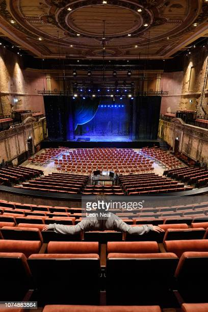 A member of the theatre team sits in the raised seating area in the restored Alexandra Palace Theatre at Alexandra Palace on November 30 2018 in...