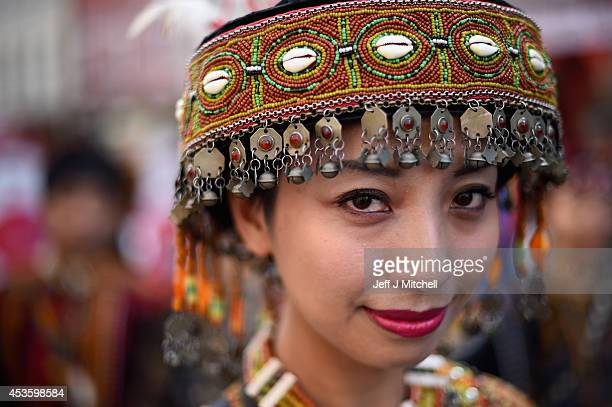 A member of the Tjimur dance theatre poses as she performs at the Edinburgh Festival Fringe on the Royal Mile on August 14 2014 in Edinburgh Scotland...