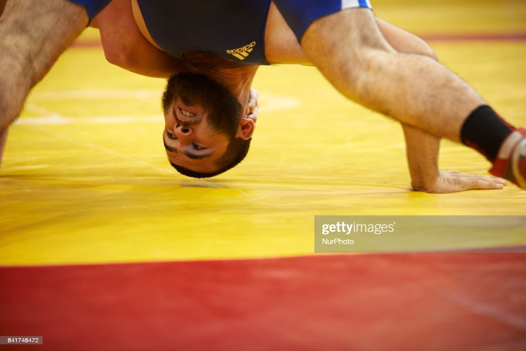A member of the TOAC Wrestling Club (in blue) fights during the FSGT World Championship. On 1st September 2017 in Clermond-Ferrand, France.