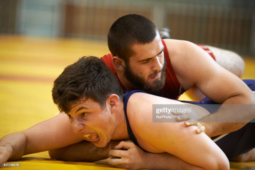 A member of the TOAC Wrestling Club (in red) fights during the FSGT World Championship. On 1st September 2017 in Clermond-Ferrand, France.