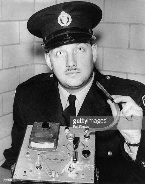 A member of the Toronto Canada police force showing a breathalyser equipment by the Stephenson Corporation of New Jersey USA which they use to test...