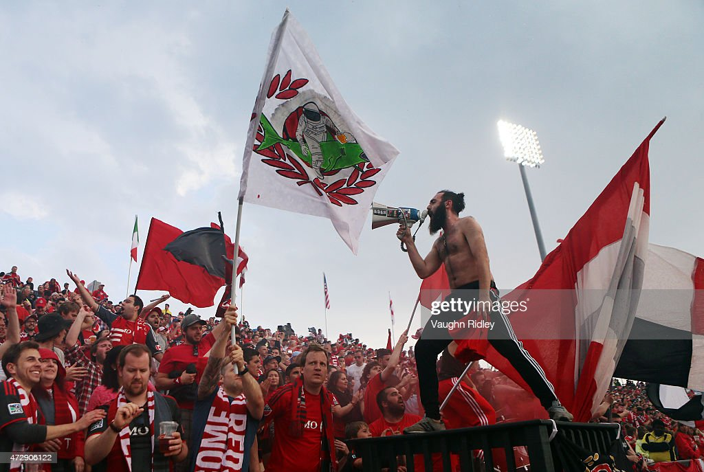 A member of the Toronto FC supporters group Inebriatti sings during an MLS soccer game between the Houston Dynamo and Toronto FC at BMO Field on May 10, 2015 in Toronto, Ontario, Canada.