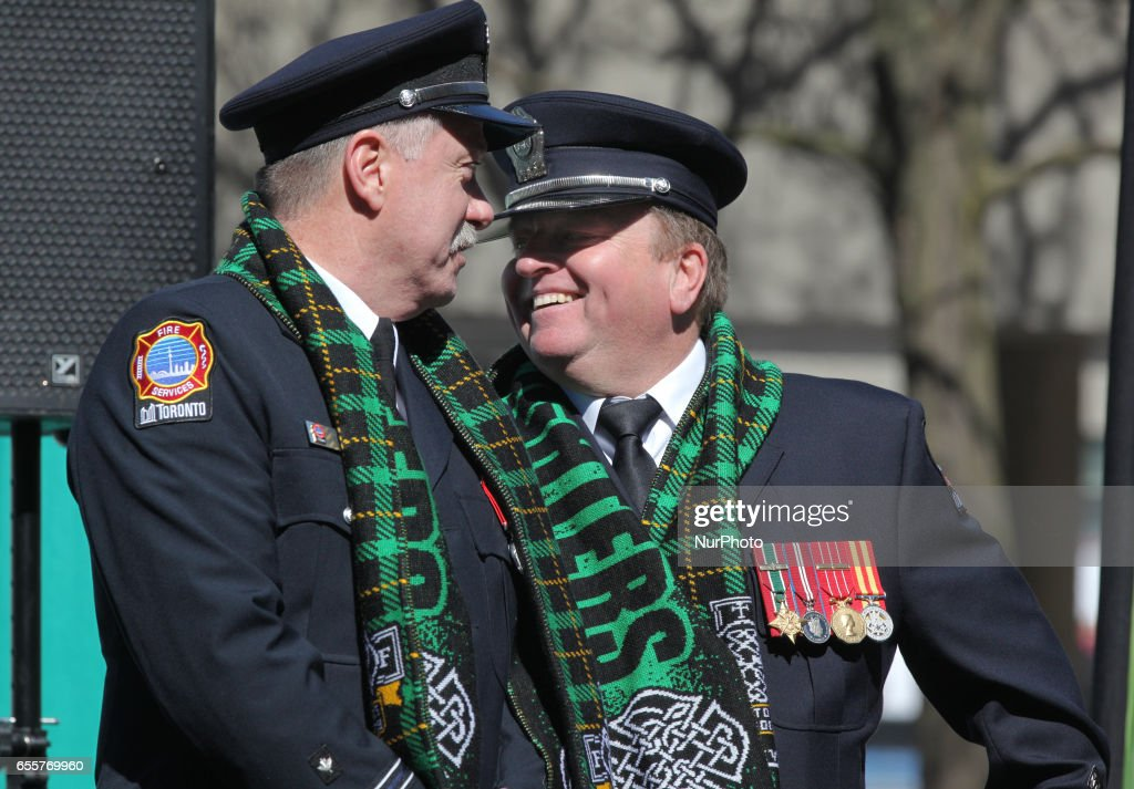 Member of the Toronto Fire Celtic Society take part in the St. Patrick's Day Parade in Toronto, Ontario, Canada, on March 19, 2017.