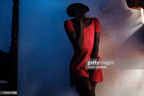 A member of the transgender and LGBTQ community poses for photographer before attends the Transgender day of Remembrance in order to pay tributes to...