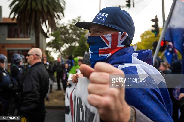 A member of the True Blue Crew baits the left leaning Anti Racism supporters from behind police lines at on May 28 2016 in Melbourne Australia...