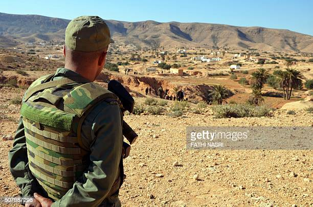 A member of the Tunisian security forces takes part in a security sweep in the mountainous Tounine area some 30 kilometres south of the coastal town...