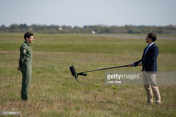 A member of the UK Armed Forces is interviewed while respecting social distancing rules after working with NHS medical staff and Air Ambulance...