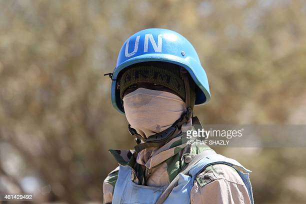 Member of the UN-African Union mission in Darfur looks on while patrolling the area near the city of Nyala in Sudan's Darfur on January 12, 2015....