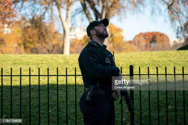 A member of the Uniformed US Secret Service stands guard outside of the Brady Press Briefing Room at the White House on November 26 2019 in...