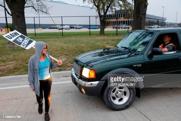 TOPSHOT A member of the United Auto Workers Jennifer Odum who is employed at the General Motors Co Flint Assembly plant in Flint Michigan slow down...