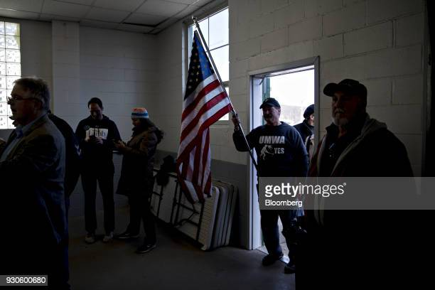 A member of the United Mine Workers of America holds an American flag before a campaign rally with Conor Lamb Democratic candidate for the US House...