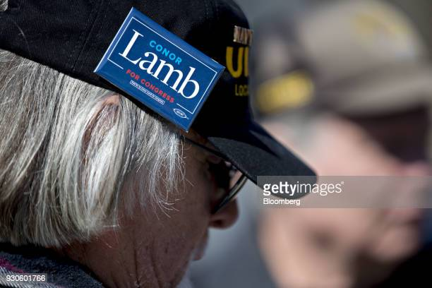 A member of the United Mine Workers of America wears a Conor Lamb Democratic candidate for the US House of Representatives pin before the start of a...