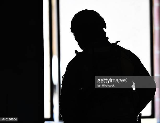 Member of the United States Air Force 129th Pararescue Squadron looks out for simulated enemy at the site of a simulated IED stike on July 6 2016 in...