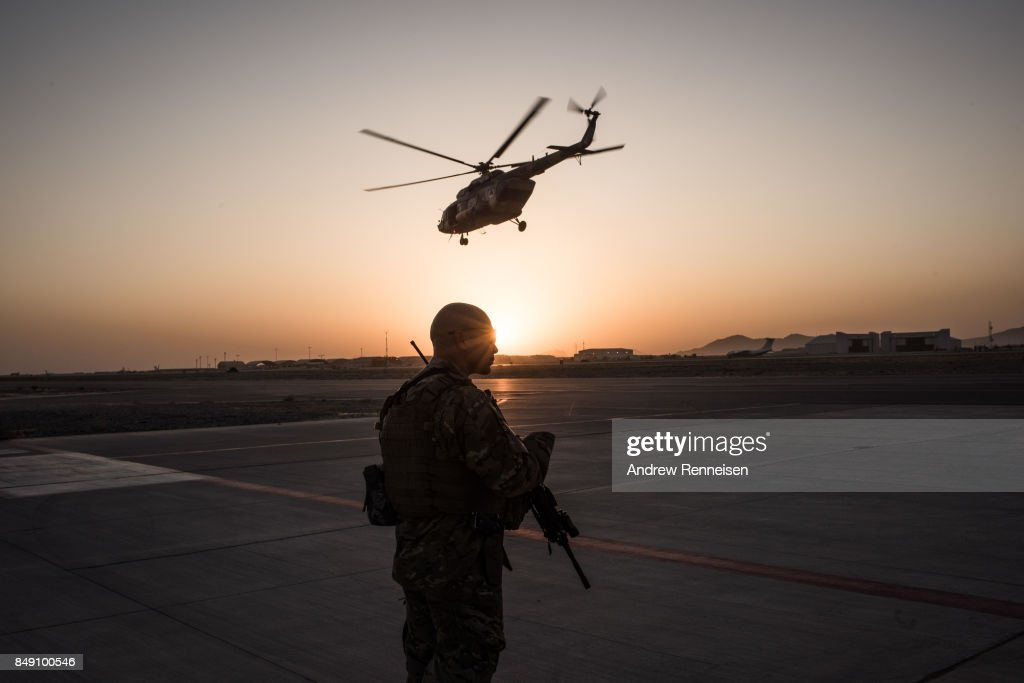 A member of the United States Air Force keeps watch over the runway on September 9, 2017 at Kandahar Air Field in Kandahar, Afghanistan. Currently the United States has about 11,000 troops in the deployed in Afghanistan, with a reported 4,000 more expected to arrive in the coming weeks. With an increase in troops, American trainers hope to expand the capability of the Afghanistan Air Force.