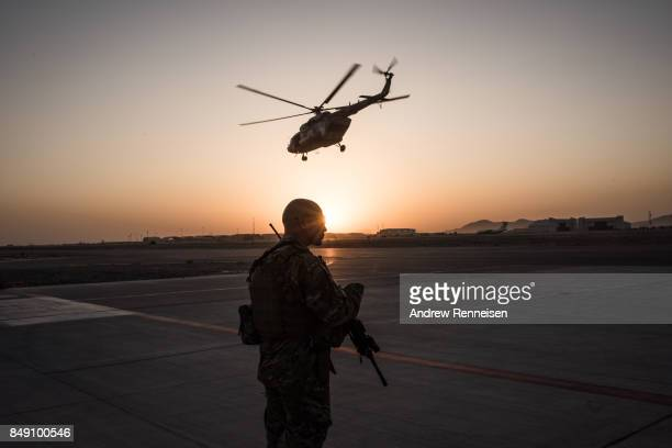 Member of the United States Air Force keeps watch over the runway on September 9, 2017 at Kandahar Air Field in Kandahar, Afghanistan. Currently the...