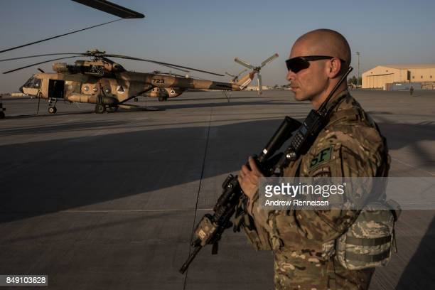 A member of the United States Air Force keeps watch over the runway on September 9 2017 at Kandahar Air Field in Kandahar Afghanistan Currently the...
