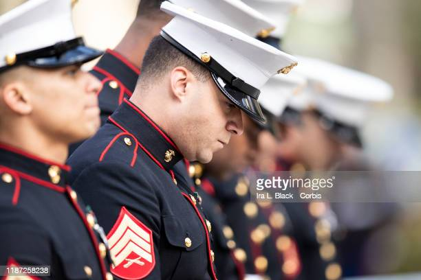 A member of the United States Marine Corps holds his head down as he stands in line listening to the 45th President Donald J Trump's address of the...