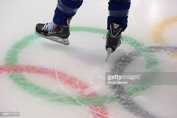 A member of the United States women's ice hockey team skates over the Olympic rings logo during a practice session ahead of the Sochi 2014 Winter...