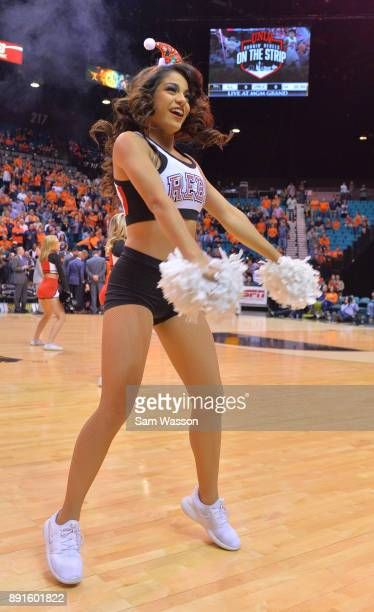 A member of the UNLV Rebels dance team performs before the team's game against the Illinois Fighting Illini at the MGM Grand Garden Arena on December...