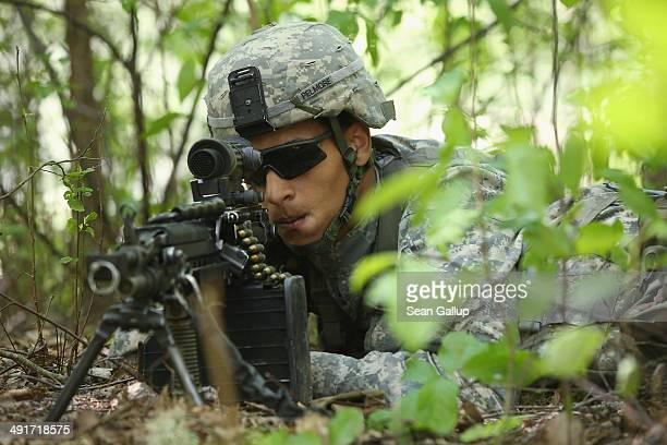 A member of the US 173rd Airborne Brigade participates in the NATO 'Spring Storm' military exercises on May 17 2014 near Otepaa Estonia The annual...