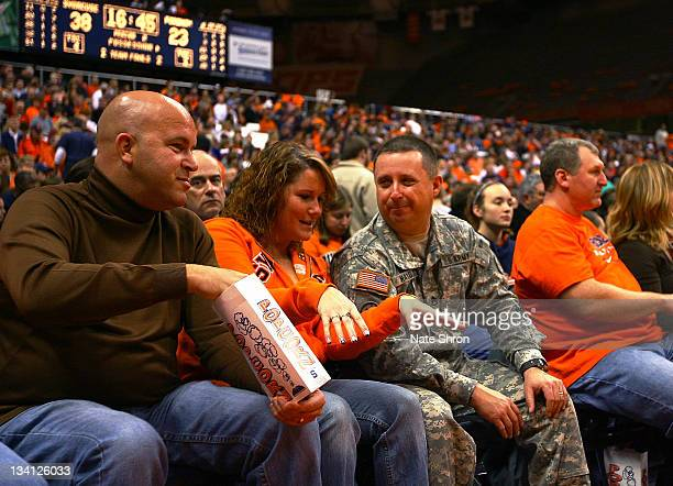 A member of the US Army enjoys the Syracuse Orange game vs the Fordham University Rams on Veterans day weekend at the Carrier Dome on November 12...