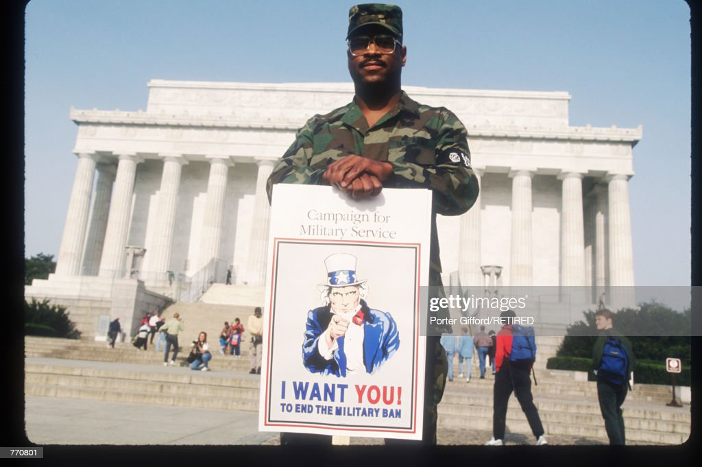 A member of the US Army holds a sign during the Gay Rights March April 25, 1993 in Washington, DC. Over 500,000 gays, lesbians and bisexual activists and their friends and families participated in the largest gathering of gay men and lesbians in history organized to end discrimination.