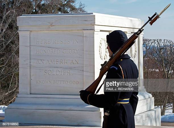 A member of the US Army Honor Guard on duty at the Tomb of the Unknown Soldier conducts his guard duty January 28 at Arlington National Cemetery in...