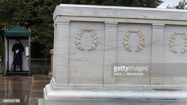A member of the US Army Honor Guard stands his post before the Tomb of the Unknown Soldier November 10 2015 at Arlington National in Arlington...