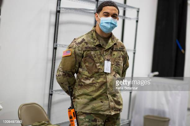 Member of the U.S Army stands inside the New Jersey Convention Center on April 8, 2020 in Edison, New Jersey. Workers set up a field medical station...