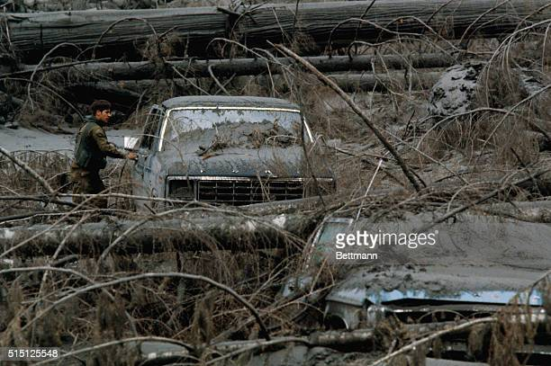 A member of the US Army stationed at Ft Lewis Washington breaks a window of a pickup truck in the Green River area near Mt St Helens as the search...