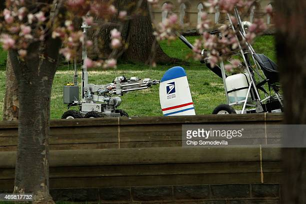 A member of the US Capitol Police Bomb Squad robot secures a gyrocopter that landed on the West Front of the US Capitol April 15 2015 in Washington...