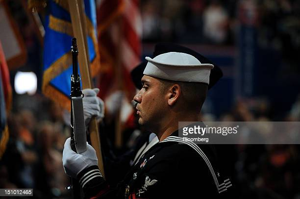 Member of the U.S. Central Command Joint Forces Color Guard Team stands at the Republican National Convention in Tampa, Florida, U.S., on Thursday,...