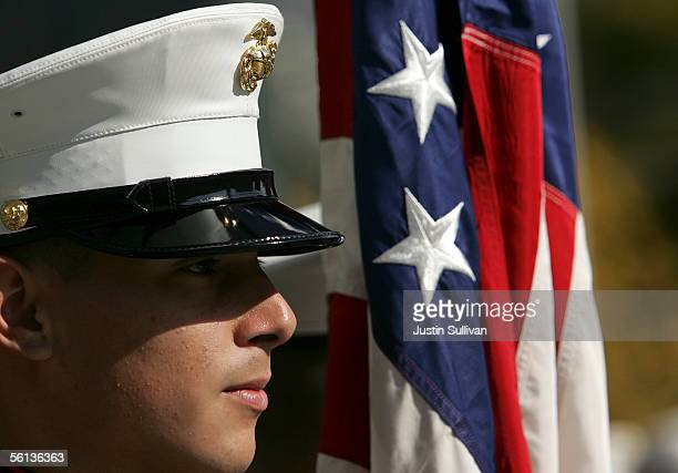 A member of the US Marine Corp honor guard stands next to the American flag during the unveiling ceremony of the new Distinguished Marines...