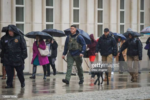 Member of the U.S. Marshals patrols with a dog outside the United States District Court for the Eastern District of New York on the first day of the...