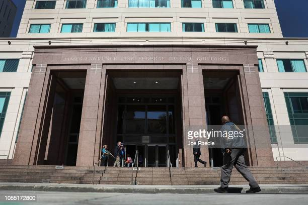 A member of the US Marshals Service walks in front of the Federal District court for the Southern District of Florida where Cesar Sayoc will be...