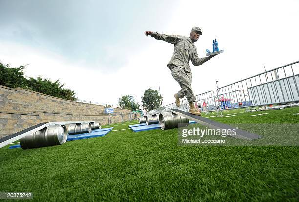 A member of the US Military participates as Bud Light and Marcus Allen Launch NFL Fan Camp at Pro Football Hall of Fame on August 5 2011 in Canton...