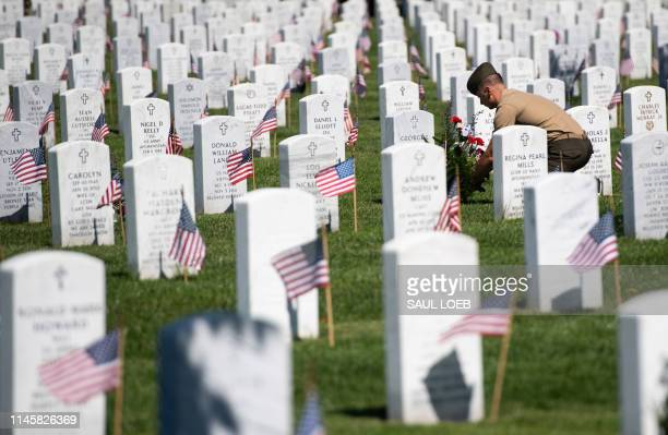 A member of the US military visits Section 60 at Arlington National Cemetery in Arlington Virginia May 24 ahead of the Memorial Day weekend Section...