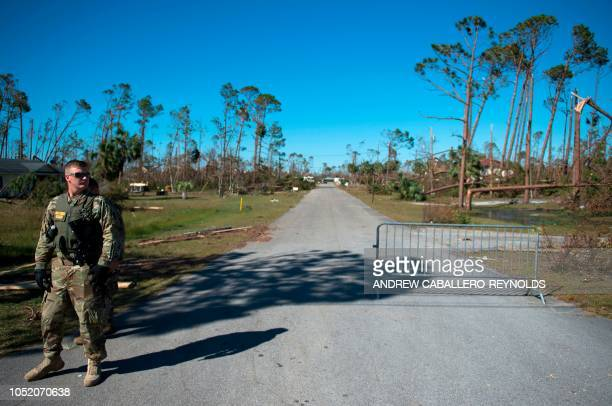 A member of the US National Guard monitors a road in Port St Joe beach Florida on October 13 three days after hurricane Michael hit the area Since...