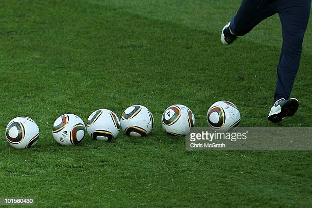 Member of the US national soccer squad kicks a line of balls during practice on June 2, 2010 in Pretoria, South Africa.