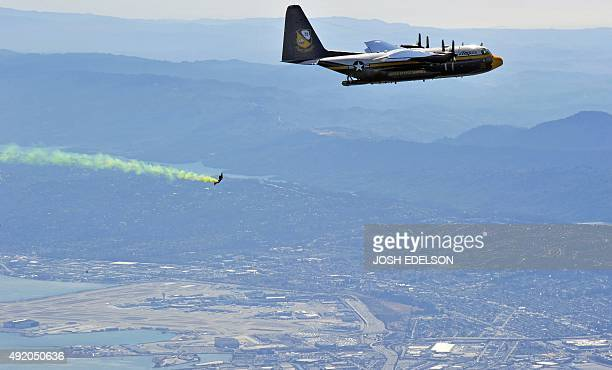 A member of the US Navy Parachute Team 'Leap Frogs' falls through the air after jumping from the US Navy Blue Angels' C130T Hercules supply plane...