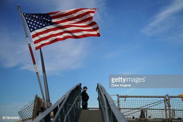 A member of the US Navy stands aboard the USS The Sullivans as it sits docked in New York Harbor November 10 2017 in the Staten Island borough of New...