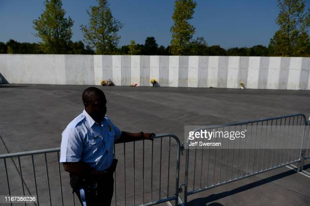 A member of the US Park Police stands at a fence along the Wall of Names at the Flight 93 National Memorial on September 11 2019 in Shanksville...