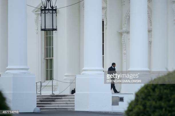 A member of the US Secret Service is seen outside the White House October 23 2014 in Washington DC A suspect who climbed over the White House fence...
