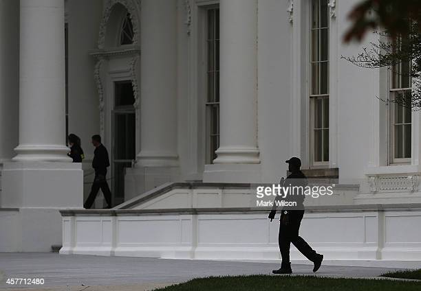 A member of the US Secret Service patrols in front of White House October 23 2014 in Washington DC Last evening Dominic Adesanya of Bel Air Maryland...
