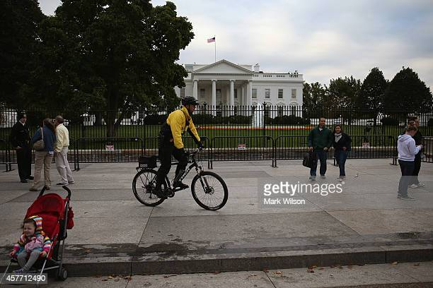 A member of the US Secret Service patrols on a bicycle in front of White House October 23 2014 in Washington DC Last evening Dominic Adesanya of Bel...