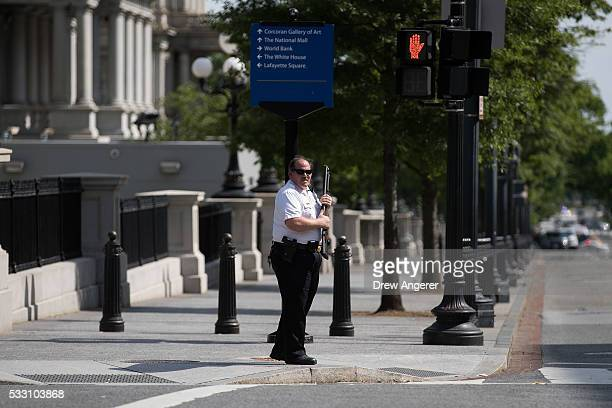 A member of the US Secret Service patrols the corner of 17th Street and Pennsylvania Ave after a shooting was reported near the White House May 20 in...